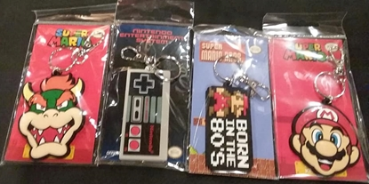Picture of PYRAMID AMERICA SUPER NINTENDO SUPER MARIO BROS KEYCHAIN SET OF 4